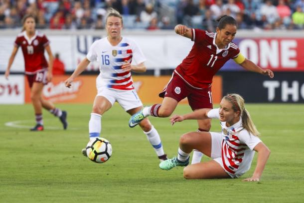 Lindsey Horan challenges Monica Ocampo for the ball | Source: Logan Bowles-Getty Images