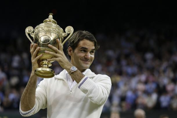 Federer holds up the Gentlemen's singles trophy for the seventh time in 2012. Credit: Associated Press