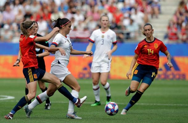 Alex Morgan (13) took a lot of knocks in this physical match as Spain consistently put a body on her. | Photo: AP Photo - Alessandra Tarantino