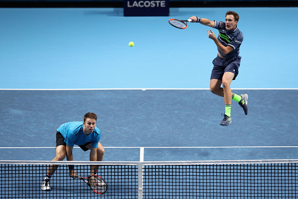 Henri Kontinen returns a shot with John Peers ready to pounce (Photo: Julian Finney/Getty Images)