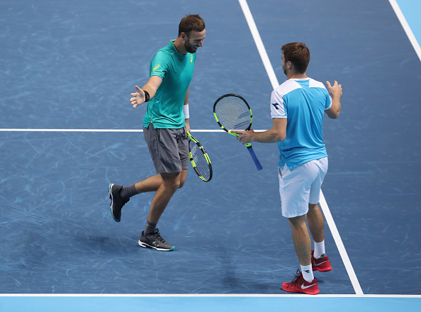 Ryan Harrison and Michael Venus high five after putting away match point to clinch victory (Photo: Julian Finney/Getty Images)