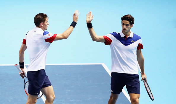 Pierre-Hugues Herbert and Nicolas Mahut high five after winning a point (Photo: Clive Brunskill/Getty Images)