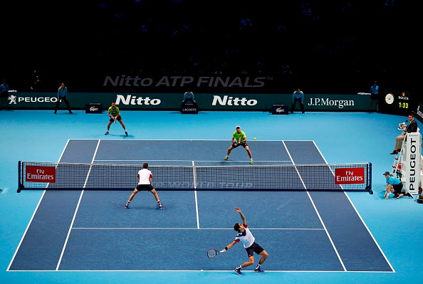 All four players in action during the night session (Photo: Adrian Dennis/Getty Images)