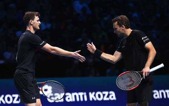 Jamie Murray and Bruno Soares high five after taking the second set (Photo: Clive Brunskill/Getty Images)