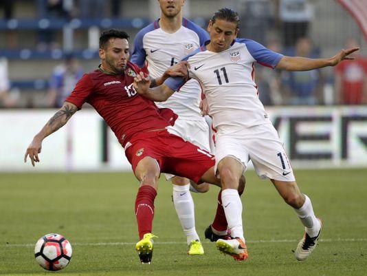 American/Bolivian midfielder Alejandro Melean holding off United States' midfielder Alejandro Bedoya in the 4-0 defeat for La Verde on Saturday at Children's Mercy Park | Colin E. Braley -  AP
