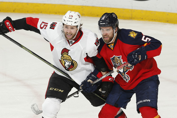 Zack Smith #15 of the Ottawa Senators and Aaron Ekblad #5 of the Florida Panthers battle for position during third period action at the BB&T Center on December 8, 2015 in Sunrise, Florida. The Senators defeated the anthers 4-2. (Dec. 7, 2015 - Source: Joel Auerbach/Getty Images North America)