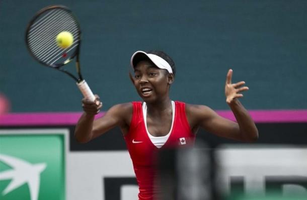 Francoise Abanda plays a forehand during her second rubber. Photo: Roman Benicky/Fed Cup