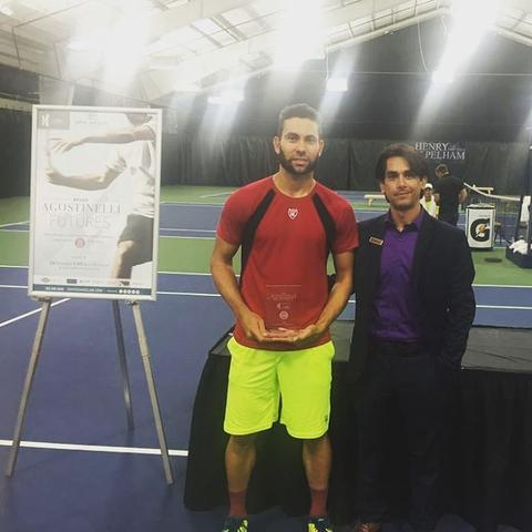 Adam El Mihdawy poses with the winner's trophy after winning the 2016 Bruno Agostinelli Futures.   Photo via Loriet
