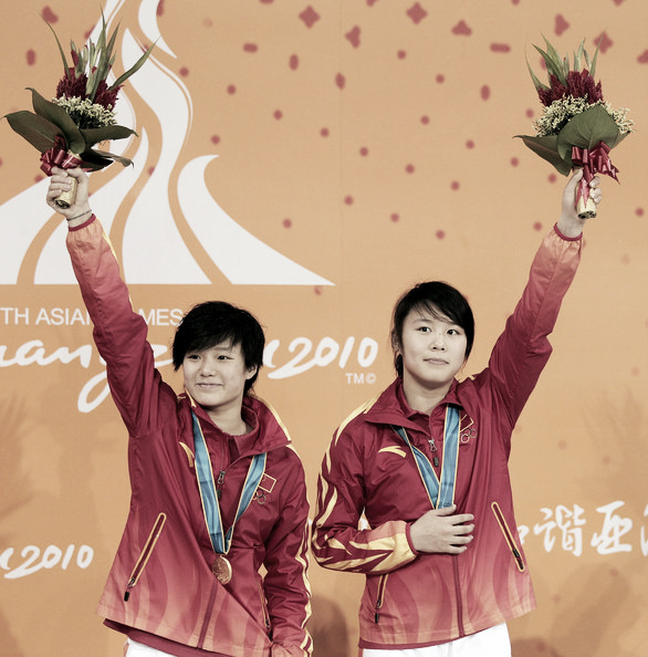 The Chinese pair celebrating a victory in 2010. Photo Credit; Adam Pretty of Getty Images AsiaPac