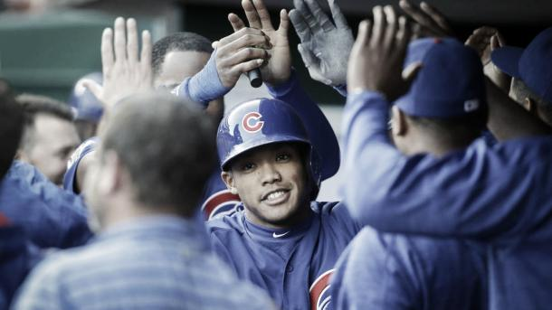 Addison Russel high fives teammates after his home run in the second inning of Saturday nights game in Cincinnati (AP)