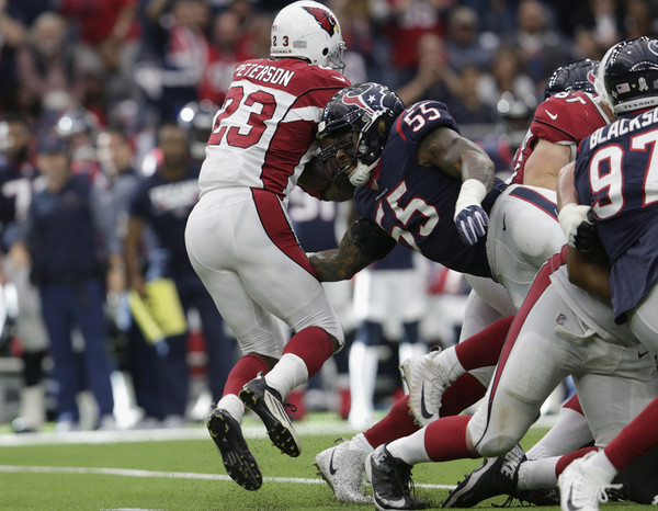 Benardrick McKinney #55 of the Houston Texans hits Adrian Peterson #23 of the Arizona Cardinals behind the line of scrimmage in the fourth quarter. |Source: Tim Warner/Getty Images North America|