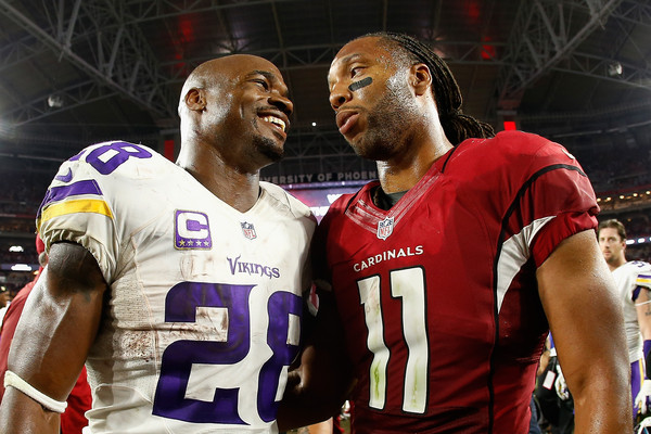 Running back Adrian Peterson #28 of the Minnesota Vikings and wide receiver Larry Fitzgerald #11 of the Arizona Cardinals talk on the field. The Cardinals defeated the Vikings 23-20. |Dec. 9, 2015 - Source: Christian Petersen/Getty Images North America|