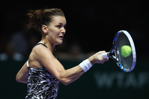 Agnieszka Radwanska hits a forehand during her semifinal match against Angelique Kerber at the 2016 BNP Paribas WTA Finals Singapore presented by SC Global. | Photo: Julian Finney/Getty Images