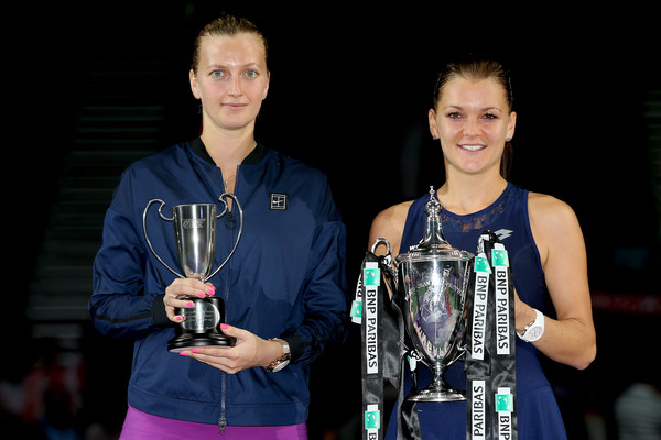 Petra Kvitova of Czech Republic and Agnieszka Radwanska of Poland pose with their trophies after their final match during the BNP Paribas WTA Finals, which Radwanka won in three sets, at Singapore Sports Hub on November 1, 2015 in Singapore. | Photo: Matthew Stockman/Getty Images AsiaPac