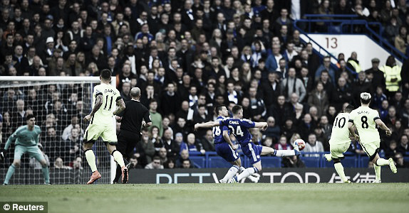 Above; Sergio Aguero strikes home his first of two goals in Chelsea's 2-0 defeat to Manchester City | Reuters