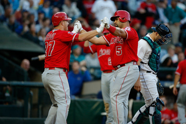 Albert Pujols #5 of the Los Angeles Angels of Anaheim is congratulated by Mike Trout #27 after hitting a two-run homer. |Sept. 2, 2016 - Source: Otto Greule Jr/Getty Images North America|