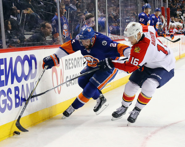 Nick Leddy #2 of the New York Islanders moves the puck around Aleksander Barkov #16 of the Florida Panthers during the second period at the Barclays Center on March 14, 2016 in the Brooklyn borough of New York City. (March 13, 2016 - Source: Bruce Bennett/Getty Images North America)