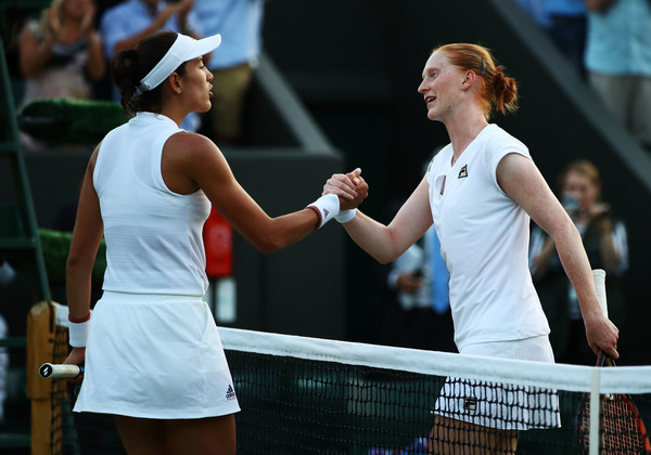 Muguruza and Van Uytvanck meet at the net after the encounter | Photo: Clive Mason/Getty Images Europe