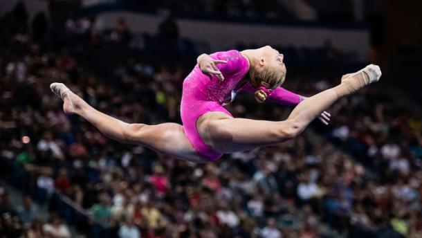 Alyssa Baumann performs on the balance beam at the Secret US Classic in Hartford/Getty Images