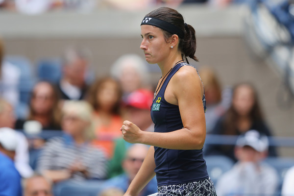 Anastasija Sevastova celebrates winning a point | Photo: Richard Heathcote/Getty Images North America