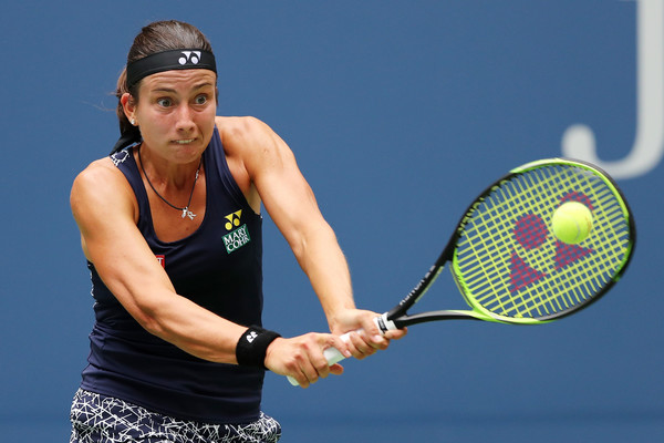 Anastasija Sevastova hits a backhand during her fourth-round match against Maria Sharapova at the 2017 U.S. Open. | Photo: Elsa/Getty Images