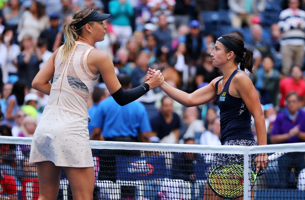 Sharapova and Sevastova meets at the net after their US Open fourth-round match | Photo: Richard Heathcote/Getty Images North America