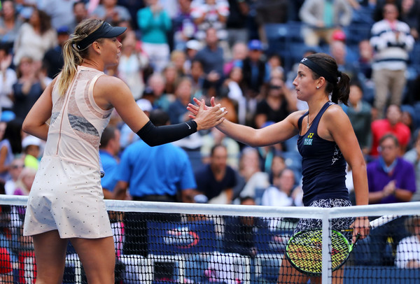 Maria Sharapova and Anastasija Sevastova shake hands after their fourth-round battle at the 2017 U.S. Open. | Photo: Richard Heathcote/Getty Images