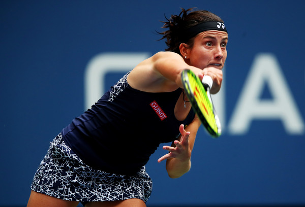 Anastasija Sevastova hits a serve during her fourth-round match against Maria Sharapova at the 2017 U.S. Open. | Photo: Clive Brunskill/Getty Images