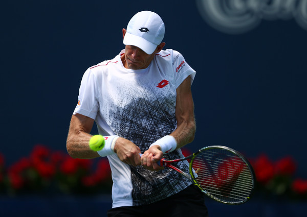 Kevin Anderson crushes one of his giant backhands during the quarterfinal win. Photo: Getty Images