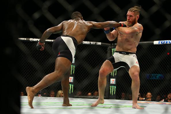 Anderson strikes Lawler   Photo: Rey Del Rio