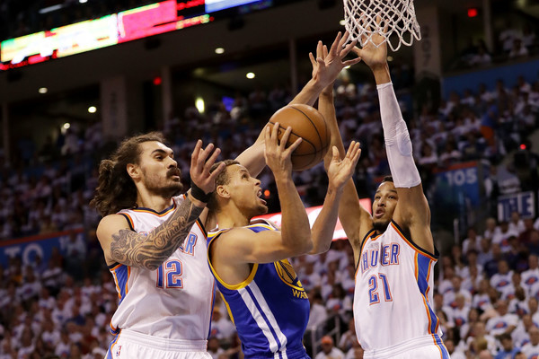 Oklahoma City Thunder guard Andre Roberson (21) comes up big for the Thunder, contesting Golden State Warriors' guard Steph Curry (30). Photo: