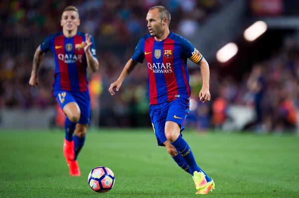 Andres Iniesta e DIgne durante il match con la Samp. Fonte foto: Getty Images Europe.