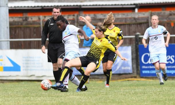 Baptiste tussles for the ball with Ellie Mason (Credit: Andrew Waller)
