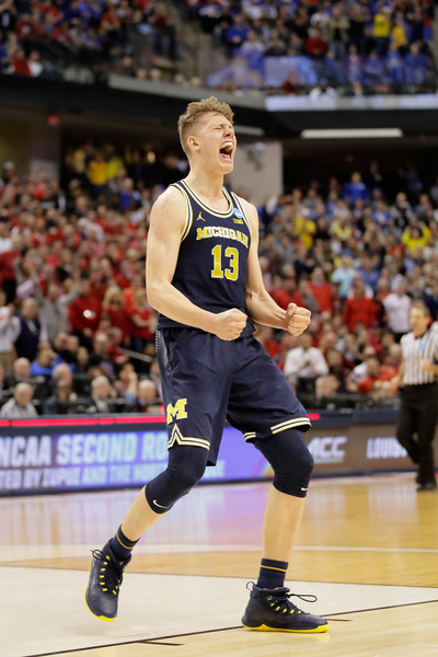 Moritz Wagner celebrates a big play vs. the Louisville Cardinals Photo Credit: Andy Lyons-Getty Images