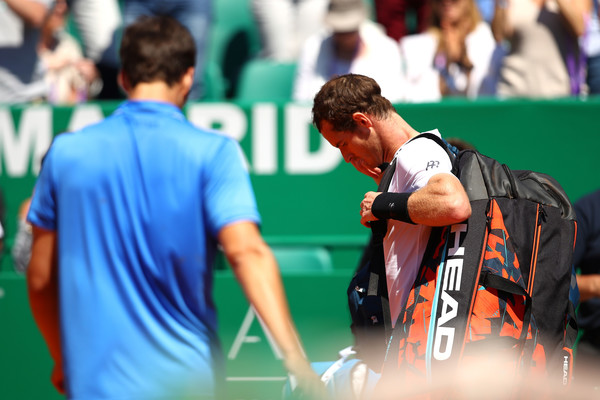 A dejected Murray exits the court (Photo: Clive Brunskill/Getty Images Europe)