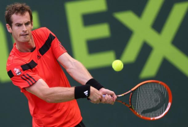 Andy Murray hits a backhand at the 2014 Qatar ExxonMobil Open in Doha/Getty Images