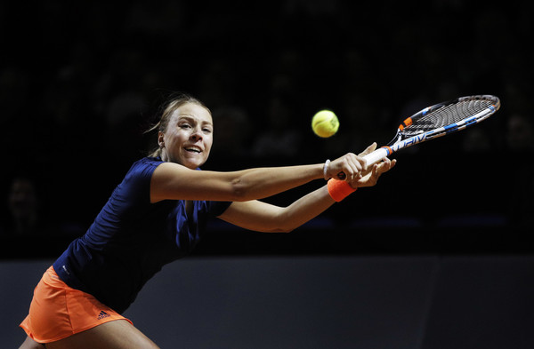 Anett Kontaveit lunges for a backhand during her quarterfinal match against Maria Sharapova at the 2017 Porsche Tennis Grand Prix. | Photo: Adam Pretty/Bongarts