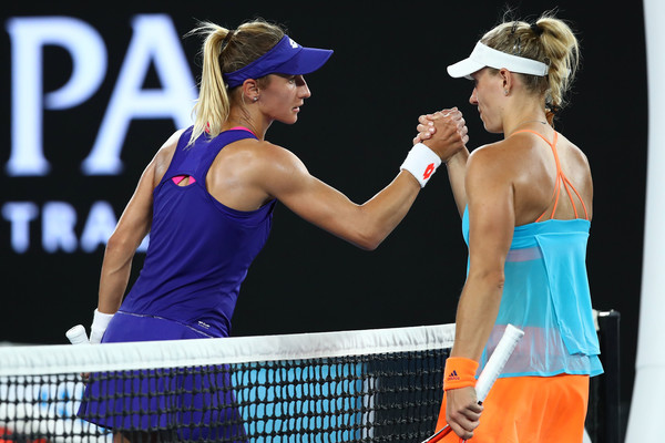 Both players meet at the net after the match | Photo: Cameron Spencer/Getty Images AsiaPac