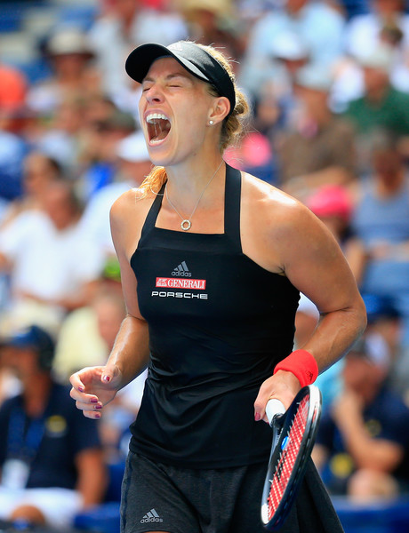 Angelique Kerber roars in delight after grabbing the win | Photo: Chris Trotman/Getty Images North America