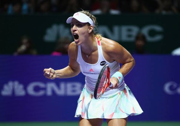 Angelique Kerber celebrates after winning a point against Dominika Cibulkova during the final of the 2016 BNP Paribas WTA Finals Singapore presented by SC Global. | Photo: Clive Brunskill/Getty Images