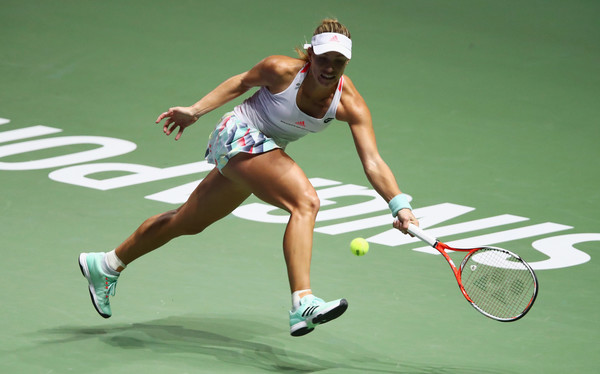 Angelique Kerber chases down a ball during her semifinal match against Agnieszka Radwanska at the 2016 BNP Paribas WTA Finals Singapore presented by SC Global. | Photo: Clive Brunskill/Getty Images
