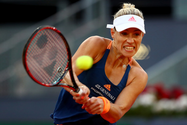 Angelique Kerber in action | Photo: Clive Rose/Getty Images Europe