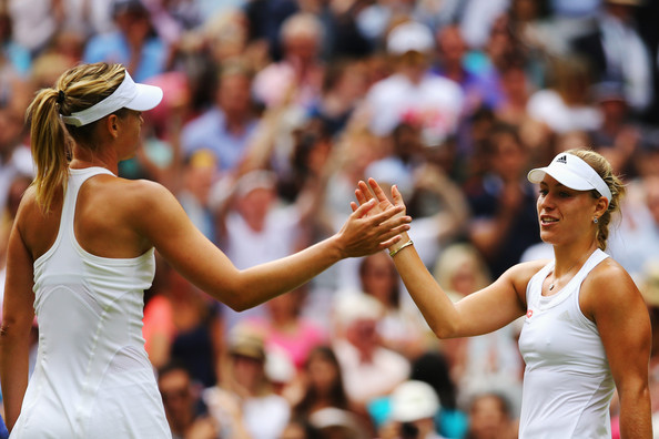 Maria Sharapova and Angelique Kerber meet at the net after their classic at Wimbledon | Photo: Al Bello/Getty Images Europe