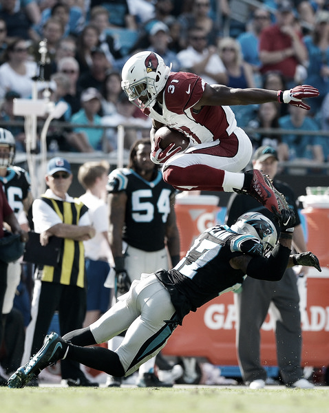 David Johnson hurtles over Robert McClain trying to get a first down against the Carolina Panthers [Source: Source: Grant Halverson/Getty Images North America]