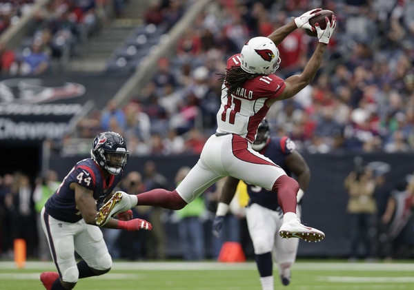Larry Fitzgerald #11 of the Arizona Cardinals catches a pass in the second quarter defended by Jelani Jenkins #44 of the Houston Texans. |Source: Tim Warner/Getty Images North America|