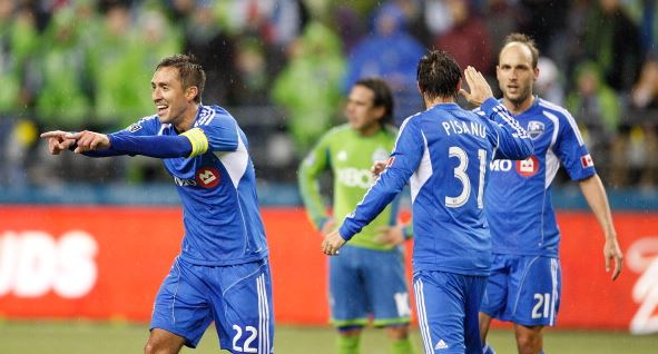 Davy Arnaud #22 of Montreal Impact celebrates his goal with teammates Andrea Pisanu #31 and Justin Mapp #21 in the first half against Seattle Sounders at CenturyLink Field on March 2, 2013 in Seattle, Washington. (Photo by Kevin Casey/Getty Images