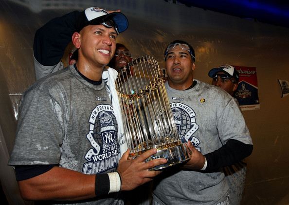 A-Rod holds the 2009 World Series trophy. Nov. 3, 2009 - Source: Nick Laham/Getty Images North America