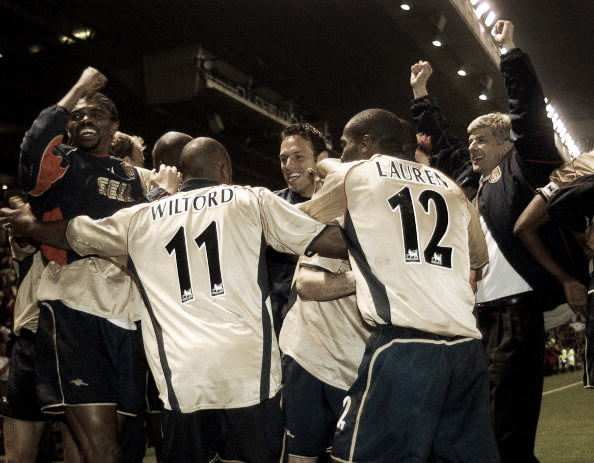 Arsenal celebrate at Old Trafford in 2002 (Photo: Paul Barker / Getty Images)