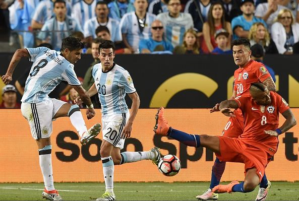 Chile midfielder Arturo Vidal (right, in red, on ground) lost his composure in Monday's loss to Argentina. Photo credit: Mark Ralston/AFP, Getty Images Sport