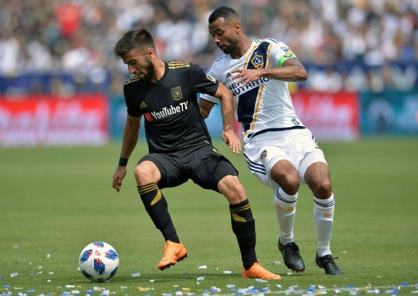 Ashley Cole fights for possession. | Photo: Gary A. Vasquez - USA TODAY Sports